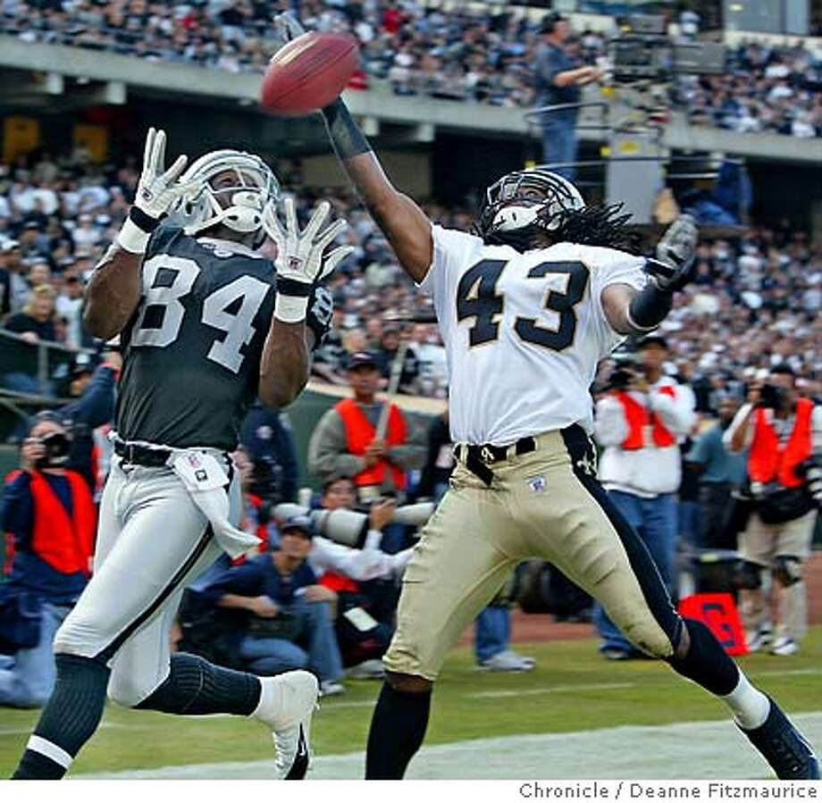 Raiders Jerry Porter can't get this pass thrown into the endzone whcih would have put them ahead - defending is Mike McKenzie. Oakland Raiders vs New Orleans Saints at Network Associates Coliseum.  Deanne Fitzmaurice / The Chronicle Photo: Deanne Fitzmaurice