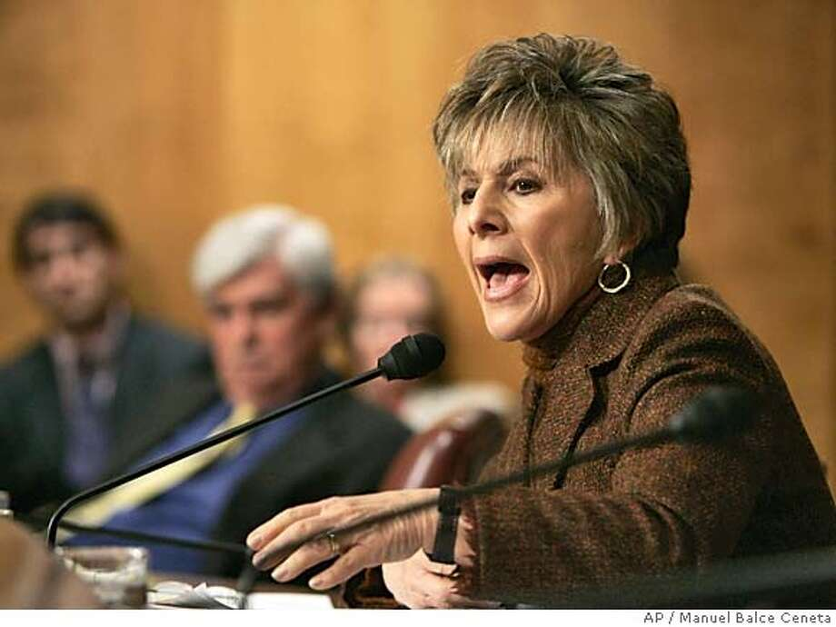 Sen. Barbara Boxer, D-Calif., makes a comment to former assistant Secretary of State for Intelligence and Research Carl W. Ford Jr., (not in picture) as he testifies before the Senate Foreign Relations Committee on the nomination of John Bolton as ambassador to the U.N on Capitol Hill, Tuesday, April 12, 2005. Ford, a former chief of the State Department's bureau of intelligence and research castigated Bolton on Tuesday as a 'kiss-up, kick-down sort of guy' who abused analysts who disagreed with his views of Cuba's weapons capabilities. Seated in back center is Sen. Christopher Dodd, D-Conn. (AP Photo/Manuel Balce Ceneta) Ran on: 04-19-2005  Boxer Photo: MANUEL BALC CENETA