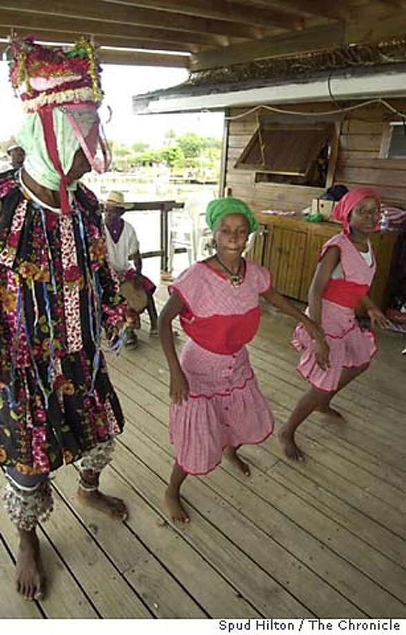 Garifuna dancers perform on the back deck of Eagle Ray's Bar & Grill in West End Village, Isla Roatan, one of the Bay Islands off Honduras. on 2/9/05.  Spud Hilton / The Chronicle Photo: Spud Hilton