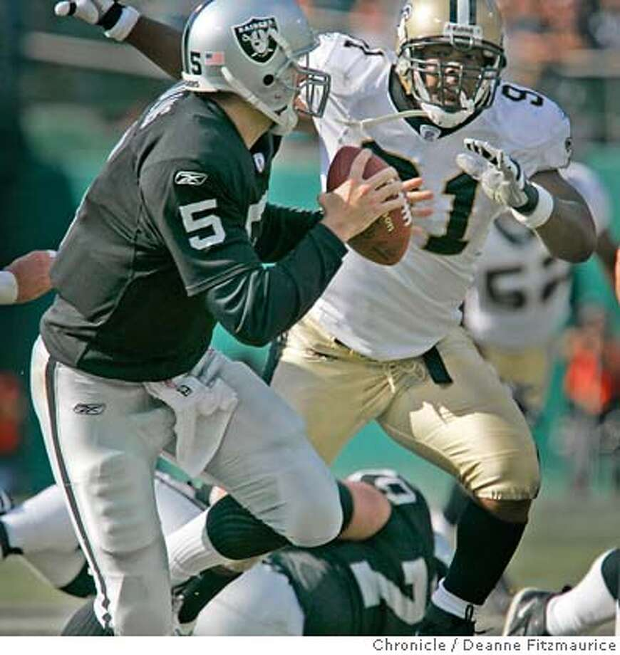 Kerry Collins get pressured by Saints defense. Oakland Raiders vs New Orleans Saints at Network Associates Coliseum.  Deanne Fitzmaurice / The Chronicle Photo: Deanne Fitzmaurice