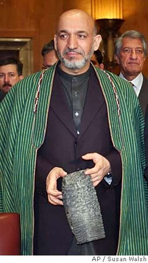 ** FILE ** Afghan interim leader Hamid Karzai arrives to testify before the Senate Foreign Relations Committee in a file photo from Feb. 26, 2003, on Capitol Hill. (AP Photo/Susan Walsh, File) Ran on: 10-25-2004  Hamid Karzai Photo: SUSAN WALSH