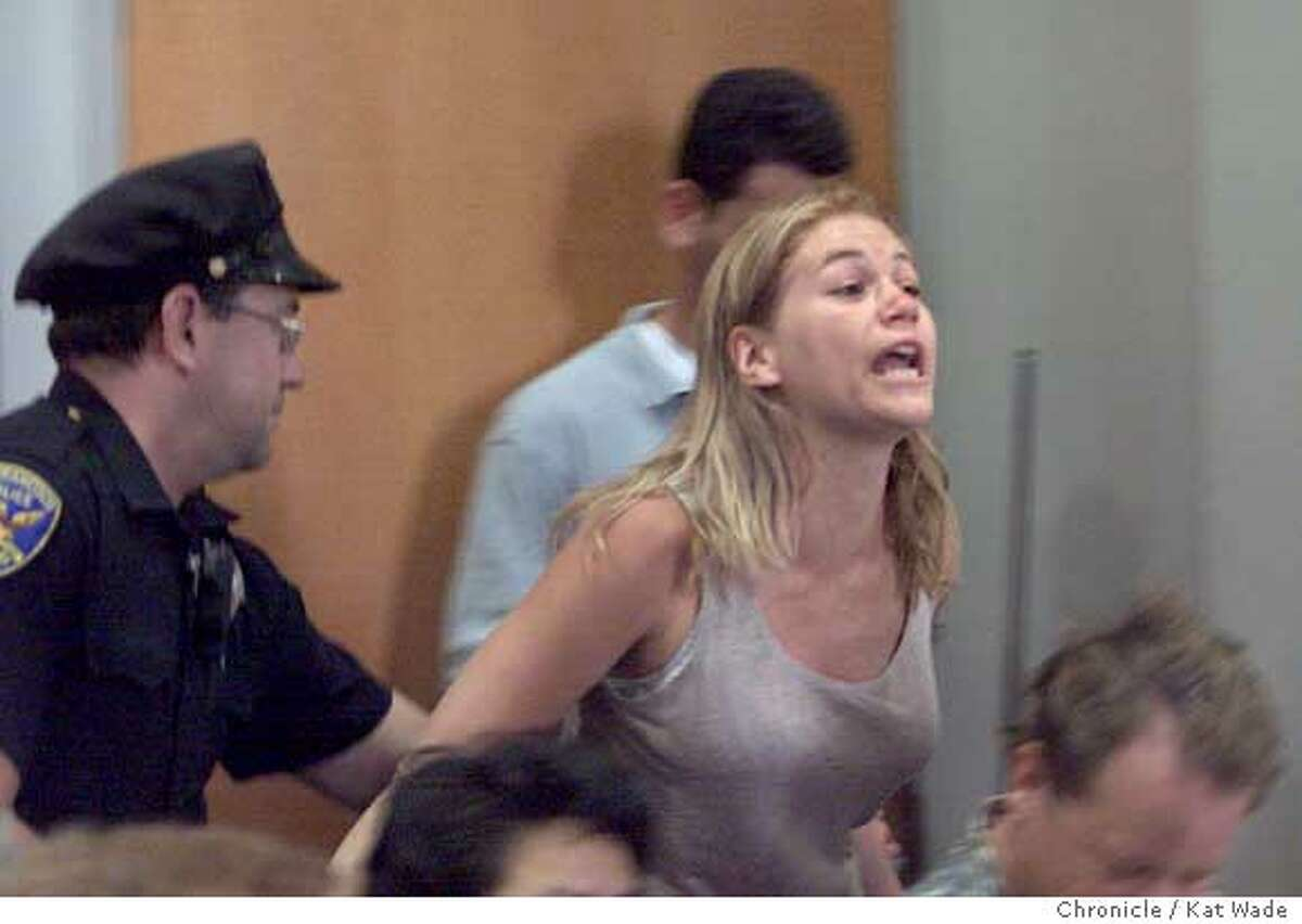 ENRON22d-C-12JUN01-MT-KW -Protester, Marla Ruzicka (CQ) with Global Exchange is hauled out of the Common Wealth Club during Enron chief executive, Jeff Skilling's speach about recent regulatory decisions over California's energy crisis. SAN FRANCISCO CHRONICLE PHOTO BY KAT WAD.E Ran on: 04-18-2005 Marla Ruzicka poses April 15 with an Iraqi family helped by the organization she founded, Campaign for Innocent Victims of Conflict. Ran on: 04-18-2005 Marla Ruzicka poses April 15 with an Iraqi family helped by the organization she founded, Campaign for Innocent Victims of Conflict.
