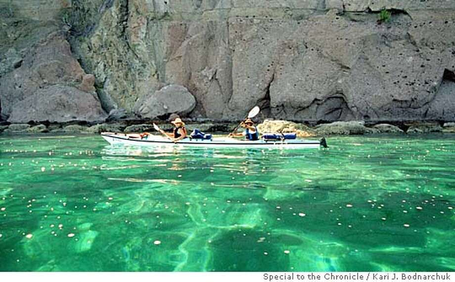 TRAVEL MEXICO The jade-colored water alongside Danzante Island (off Baja's east coast) is so clear, paddlers can see sea horses, green turtles and parrotfish from their boats.  Kari J. Bodnarchuk / Special to The Chronicle Ran on: 10-24-2004  The jade-colored waters near Isla Danzante in the Bah�a de Loreto are so clear that paddlers can see seahorses, green turtles and parrotfish from their kayaks. Photo: Kari J. Bodnarchuk