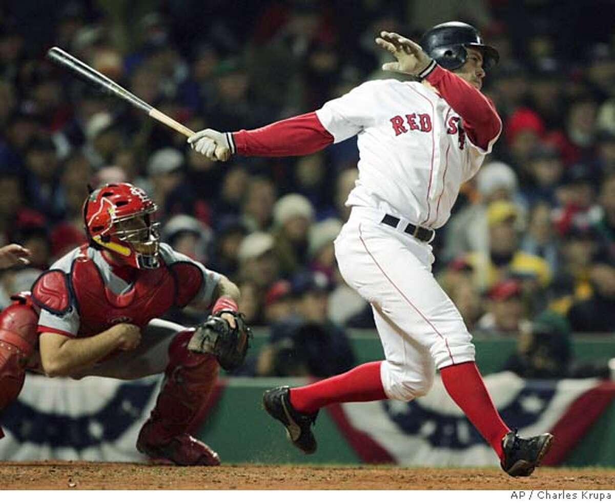 Boston Red Sox's Mark Bellhorn hits a two- RBI double in the fourth inning of Game 2 of the World Series against St. Louis Cardinals pitcher Matt Morris Sunday, Oct. 24, 2004 in Boston. (AP Photo/Charles Krupa) Sports#Sports#Chronicle#10/25/2004#ALL#5star##0422430723