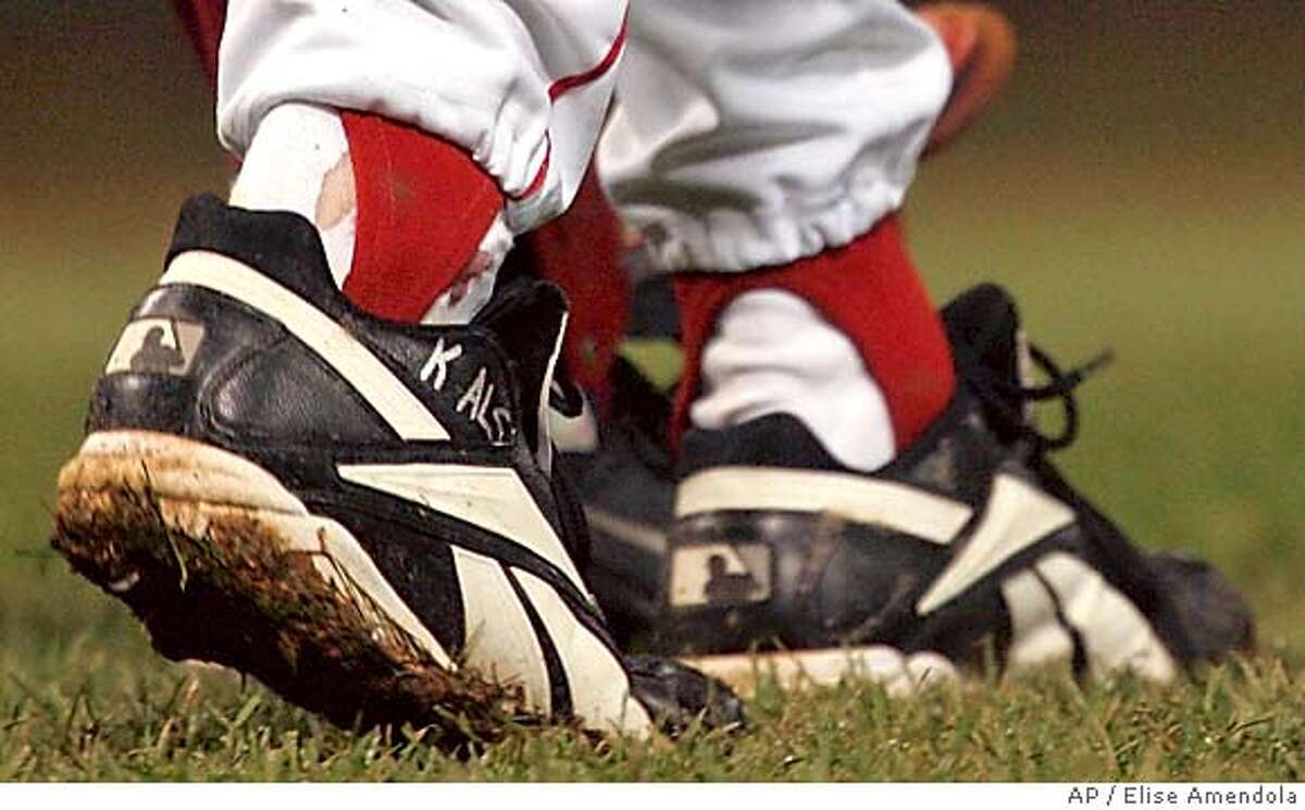 Blood is seen around the right ankle of Boston Red Sox pitcher Curt Schilling during the sixth inning of Game 2 of the World Series in Boston, Sunday, Oct. 24, 2004. Schilling was pitching with a dislocated ankle tendon held together by suture. (AP Photo/Elise Amendola) Ran on: 10-25-2004 Curt Schillings stitched-up ankle was bloody but it wasnt an issue as he held the Cardinals to one unearned run in six innings.