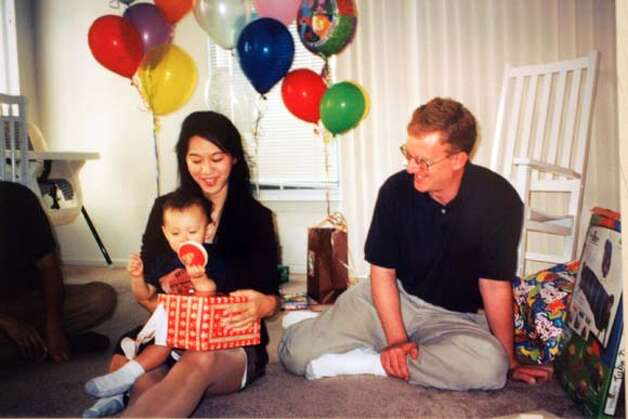Event on 11/16/04 in San Jose.  Copy photo of Iris Chang with her husband Brett Douglas and their son at his birthday party. Photos for a profile of Iris chang, a prominenet author and historian, who died of a self-inflicted gunshot wound. We go through her and her husband's (Brett Douglas) house in San jose.