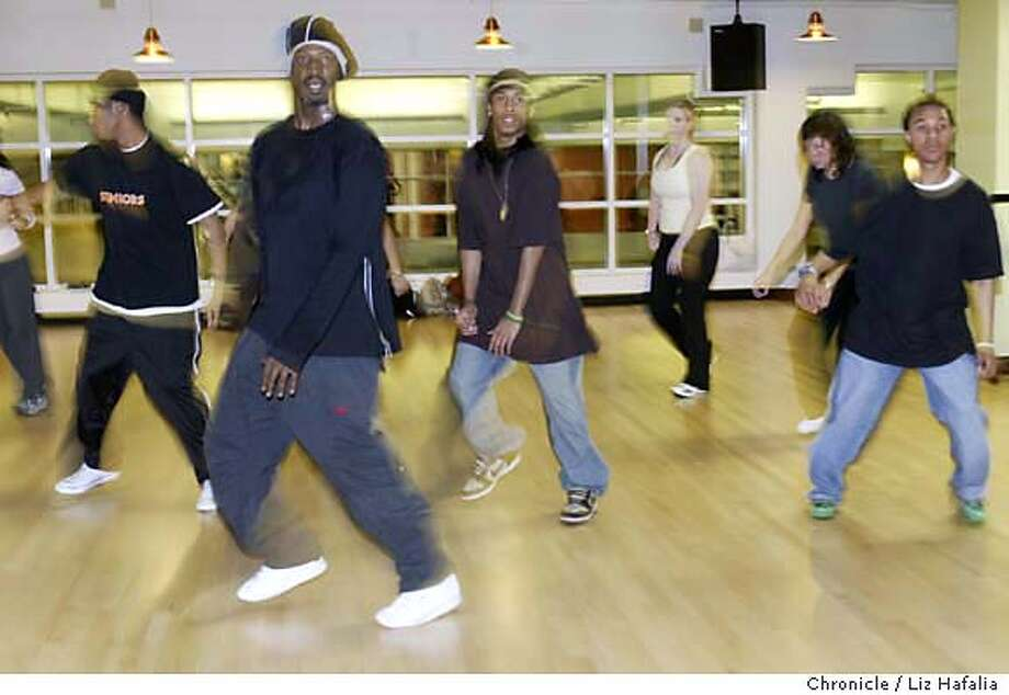 Darnell Carroll teaching hip hop dance at Club One. Hip hop class for a sunday pink piece on learning to like dancing as a viewer and participant. Shot in San Francisco on 3/24/05. Creditted to San Francisco Chronicle/Liz Hafalia Photo: Liz Hafalia