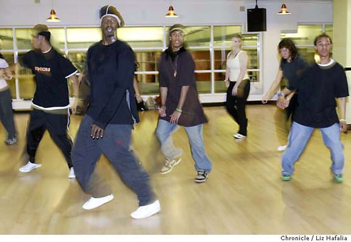 Darnell Carroll teaching hip hop dance at Club One. Hip hop class for a sunday pink piece on learning to like dancing as a viewer and participant. Shot in San Francisco on 3/24/05. Creditted to San Francisco Chronicle/Liz Hafalia