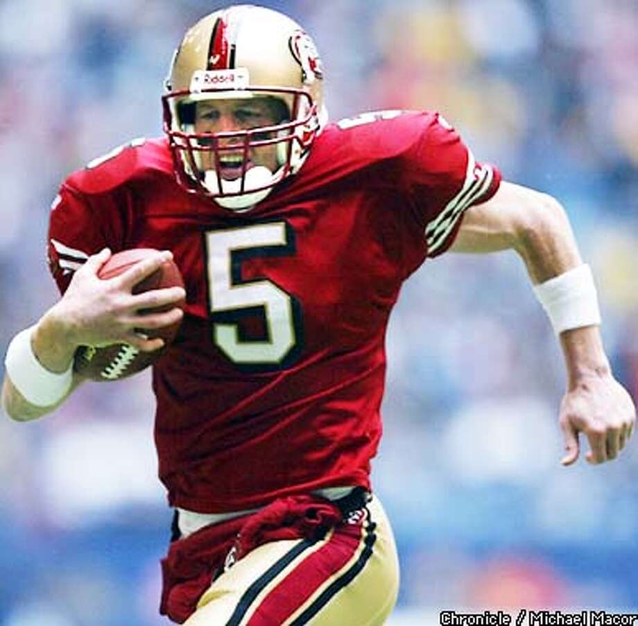 49ERS5-C-08DEC02-SP-MAC 49ers quarterback Jeff Garcia sprint to the endzone on a keeper for a TD in the 2nd quarter. San Francsico Forty Niners v. Dallas Cowboys at Texas Stadium, Irving, Texas, Dec. 8, 2002. by Michael Macor/The Chronicle