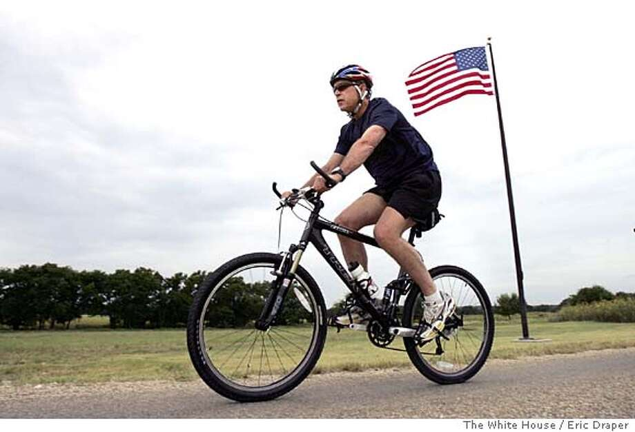 President Bush rides his bike on his ranch in Crawford, Texas, Monday, July 26, 2004. (AP Photo/The White House, Eric Draper, HO) Ran on: 07-27-2004  President Bush, suffering from an achy knee, now prefers mountain biking to jogging. Insight#Insight#Chronicle#10/24/2004#ALL#Advance##0422216885 Photo: ERIC DRAPER