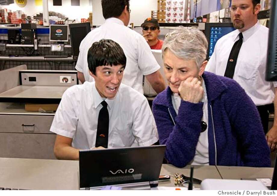"Best Buy employee, agent Josh Totemwongse helps customer Patricia Allatt of San Francisco, with her laptop computer at the Best Buy store in SF. Totemwongse is one of the employees called Counter Intelligence Agents forming the ""geek squad,"" experts that handle customer computer problems that go on call to customer's homes as well as fix things in-store.  Event on 4/6/05 in San Francisco.  Darryl Bush / The Chronicle Photo: Darryl Bush"
