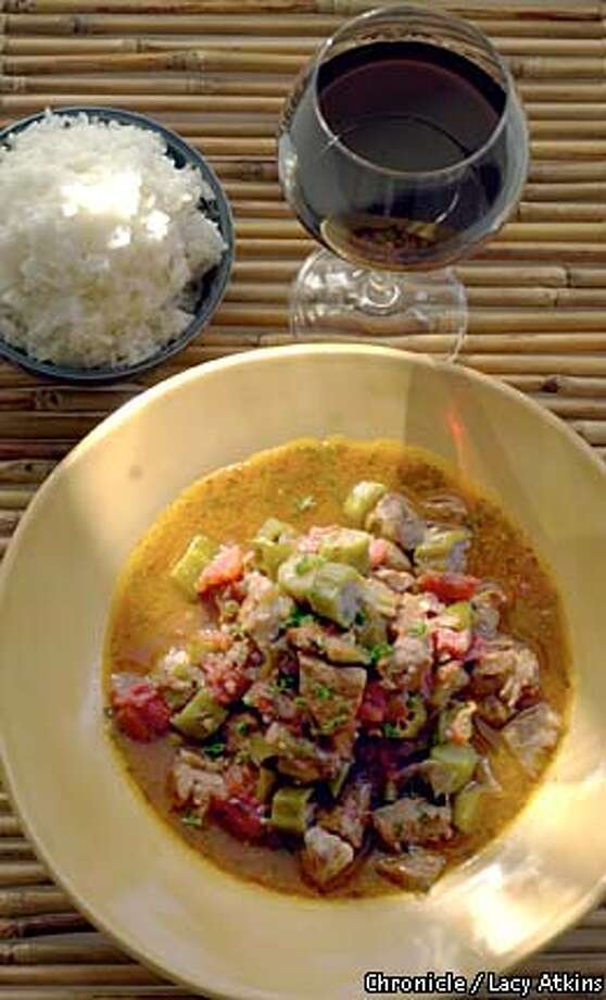 Light and Brothy: Pork Stewed With Tomatoes and Okra works well with a medium-bodied wine like Merlot. Chronicle photo by Lacy Atkins