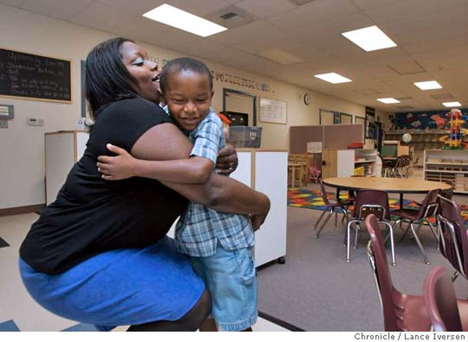 childcare0043_LI.JPG Without childcare at Pioneer Elementary School in Brentwood, Cathy Perdue doesn't know what she would do. She gets a hug from her 7 year old son Daylen (cq) after dropping him off at Aim High, day care in at 6:30am. By Lance Iversen/San Francisco Chronicle. MANDATORY CREDIT FOR PHOTOG AND SF CHRONICLE/ -MAGS OUT-WIRES SERVICES OUT/GARY FONG Metro#Metro#Chronicle#10/23/2004#ALL#5star##0422348637 Photo: Lance Iversen