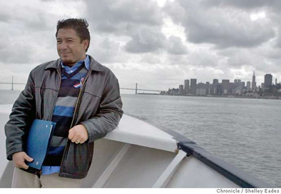 Galo Guerrero returns to SF by ferry after being sworn in at an Angel Island ceremony Monday. 20 People become New Americans in a swearing-in ceremony at Angel Island just in time to register to vote for the Nov. 4th presidential election.  Photo taken on 10/18/04 in Angel Island, CA. SHELLEY EADES/The San Francisco Chronicle Photo: SHELLEY EADES