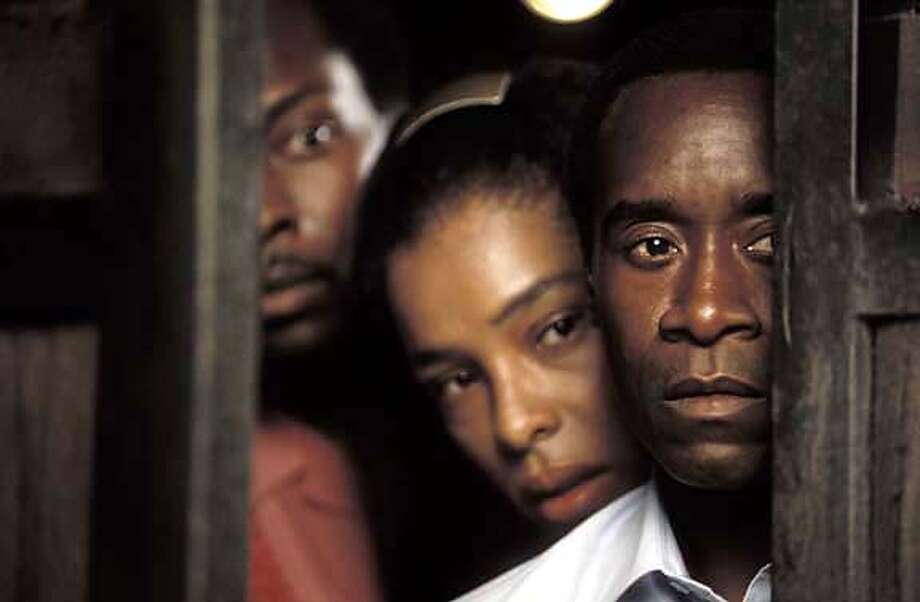 M-33 Thomas (ANTONIO LLYONS), Tatiana (SOPHIE OKONEDO) and Paul (DON CHEADLE) in United Artists' HOTEL RWANDA. Photo by Blid Alsbirk Ran on: 09-26-2004  Knut Berger and Lior Ashkenazi near the Red Sea in Eytan Fox's &quo;Walk on Water.&quo; Datebook#Datebook#SundayDateBook#10/24/2004#ALL#Advance##0422365786