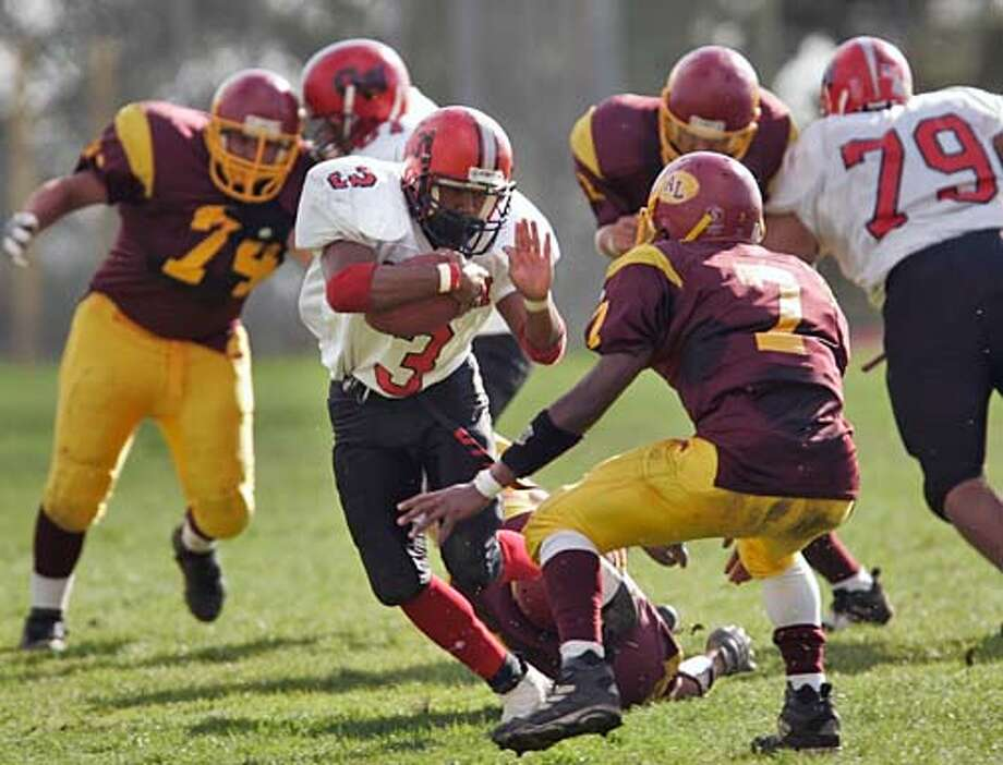 """SF23_114_kk.jpg  Washington running back Jeff McHenry (3) rushes against Lincoln's Isa Hines (7).  Washington beats Lincoln 22-21 in the """"Bell Game"""" held at Lincoln High Friday.  Photo by Handout in San Francisco Sports#Sports#Chronicle#10/23/2004#ALL#5star-dot#D2#0422427584 Photo: Handout"""