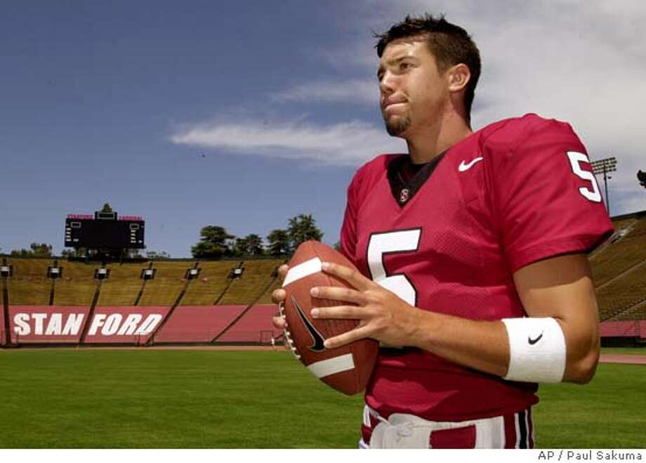 Stanford quarterback Trent Edwards prepares to pass during practice at Stanford Stadium in Stanford, Calif., Sunday, Aug. 15, 2004. Edwards, a redshirt sophomore from nearby Los Gatos, was the backup last year and shared time with Chris Lewis, starting four games. Edwards missed the Notre Dame game after being hospitalized and undergoing emergency surgery on his injured left thigh following a fourth-quarter injury in the Cal game. (AP Photo/Paul Sakuma) Ran on: 08-29-2004  Trent Edwards won, then lost the No. 1 QB job last season before undergoing emergency surgery. Ran on: 09-02-2004 Sports#Sports#Chronicle#10/23/2004#ALL#5star##0422265360 Photo: PAUL SAKUMA