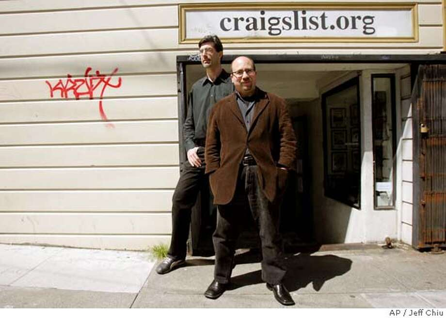 Craigslist.org CEO Jim Buckmaster, left, and founder Craig Newmark are photographed outside of their office in San Francisco on Thursday, April 14, 2005. Newspaper publishers find themselves in a confounding position as readers continue to defect to the Internet. San Francisco-based craigslist.org is one of the many Web sites that have newspaper publishers fretting. (AP Photo/Jeff Chiu) ATTENTION RICH KARECKAS Photo: JEFF CHIU
