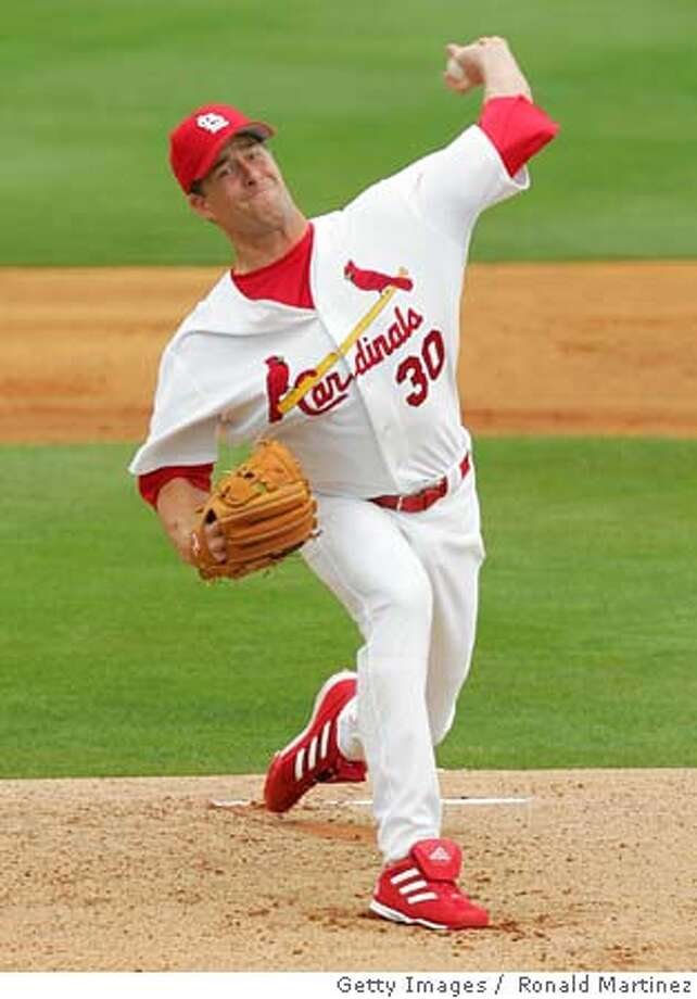 JUPITER, FL - MARCH 4: Pitcher Mark Mulder #30 of the St. Louis Cardinals throws against the New York Mets during MLB Spring Training action on March 4, 2005 at Roger Dean Stadium in Jupiter, Florida. (Photo by Ronald Martinez/Getty Images) *** Local Caption *** Mark Mulder Ran on: 03-15-2005  Tim Hudson: Career year coming. Photo: Ronald Martinez