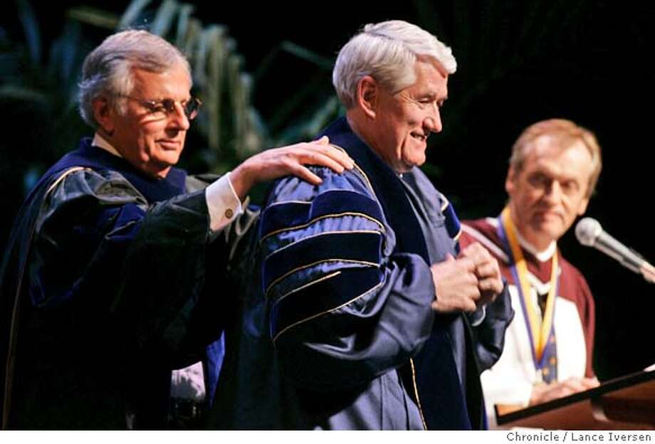 CHANCELLOR16_170.jpg_  The inauguration of UC Berkeley's new chancellor, Robert Birgeneau, took place Friday. Paul Gray, Ex vice Chancellor helps Birgeneau put on his new Berkeley gown as Robert Dynes President of UC Berkeley looks on at the ceremony held at Zellerbach Hall on campus. By Lance Iversen/San Francisco Chronicle MANDATORY CREDIT PHOTOG AND SAN FRANCISCO CHRONICLE. Photo: Lance Iversen