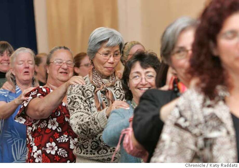 "HAWAIIAN105_RAD.JPG Na Leo Nahenahe is the only known Hawaiian choral group in the San Francisco. ""Sharing Aloha Through Song."" They sing a capella. We photograph a rehearsal at the Bethany United Methodist Church in Noe Valley, San Francisco. SHOWN: The chorus takes a quick break and and massages each others' shoulders. Annie Nakao writes for Datebook. Photo taken on 4/11/05, in San Francisco, CA.  By Katy Raddatz / The San Francisco Chronicle MANDATORY CREDIT FOR PHOTOG AND SF CHRONICLE/ -MAGS OUT Photo: Katy Raddatz"
