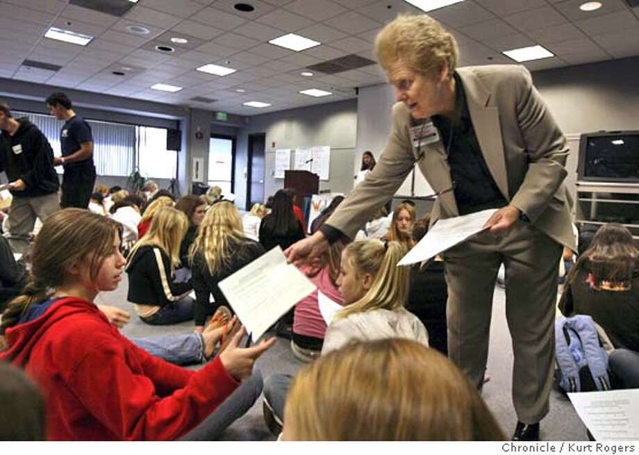 June Thompson hands out questioners to the students about what they have learned from the day .She is handing one to Alyssa Sontag.  June Thompson and nearly 100 middle school students are going to be at the Santa Clara County Office of Education San Jose Room , 1st floor. This is the perfect illus for a daily story about Thompson's moribund nonprofit, which trains student leaders. DEBT23_0061_kr.JPG 10/22/04 in San Jose,CA.  KURT ROGERS/THE CHRONICLE MANDATORY CREDIT FOR PHOTOG AND SF CHRONICLE/ -MAGS OUT Metro#Metro#Chronicle#10/23/2004#ALL#5star##0422427261 Photo: KURT ROGERS