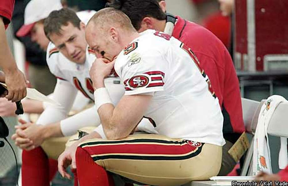 49ERSBUC13g -C-12JAN03-SP-KW - The San Francisco 49er's dejected looking Quarterback Jeff Garcia sits with second string QB Tim Rattay during the last few minutes of the game against the Tampa Bay Buccaneers during the playoff game at Raymond James Stadium, in Tampa Bay Florida Sunday January 12, 2003. SAN FRANCISCO CHRONICLE PHOTO BY KAT WADE