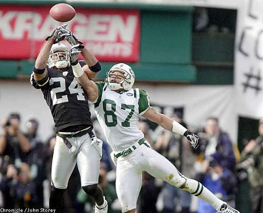 Raiders #24 Charles Woodson breaks up a pass intended for Jets #87 James Dearth in first quarter action. The Oakland Raiders play the New York Jets in an AFC playoff game at the Oakland Coliseum January 12, 2003. CHRONICLE PHOTO BY JOHN STOREY Photo: JOHN STOREY