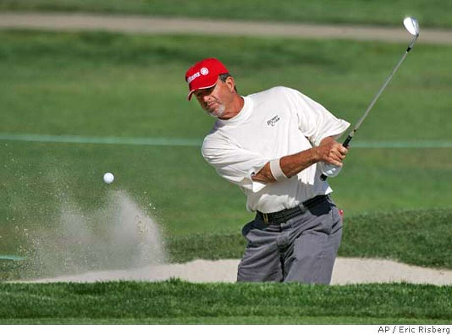 Dana Quigley follows his shot out of a bunker up to the 12th green of the Sonoma Golf Club during the first round of the Charles Schwab Cup Championship in Sonoma, Calif., Thursday Oct. 21, 2004. Quigley shot a seven-under-par 65 and is one stroke off the lead.(AP Photo/Eric Risberg) Sports#Sports#Chronicle#10/22/2004#ALL#5star#D2#0422425733 Photo: ERIC RISBERG