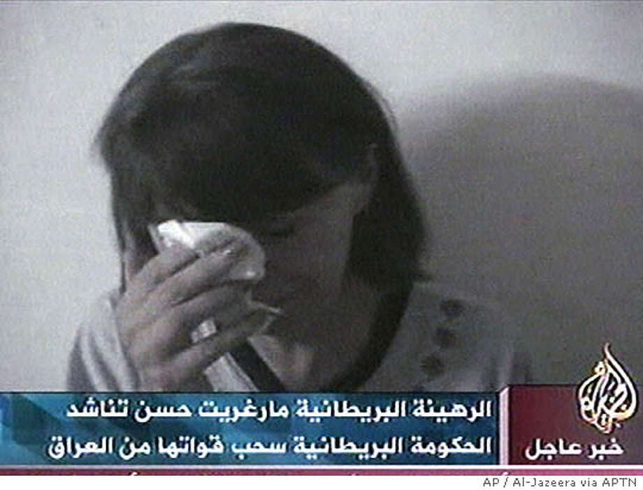 "Margaret Hassan, the kidnapped director of CARE International in Iraq, appears in this image made from television in a videotape aired by the Arabic television station Al-Jazeera, Friday, Oct. 22, 2004. Hassan is seen weeping and pleading with British Prime Minister Tony Blair to withdraw troops from Iraq ""and not bring them to Baghdad"" because ""this might be my last hours."" ""Please help me. Please help me,"" said a terrified Hassan, breaking down in tears and burying her face in a tissue. She said she might be killed like British hostage Kenneth Bigley, who was beheaded by his captors earlier this month. (AP Photo/Al-Jazzera via APTN) ** TV OUT **"