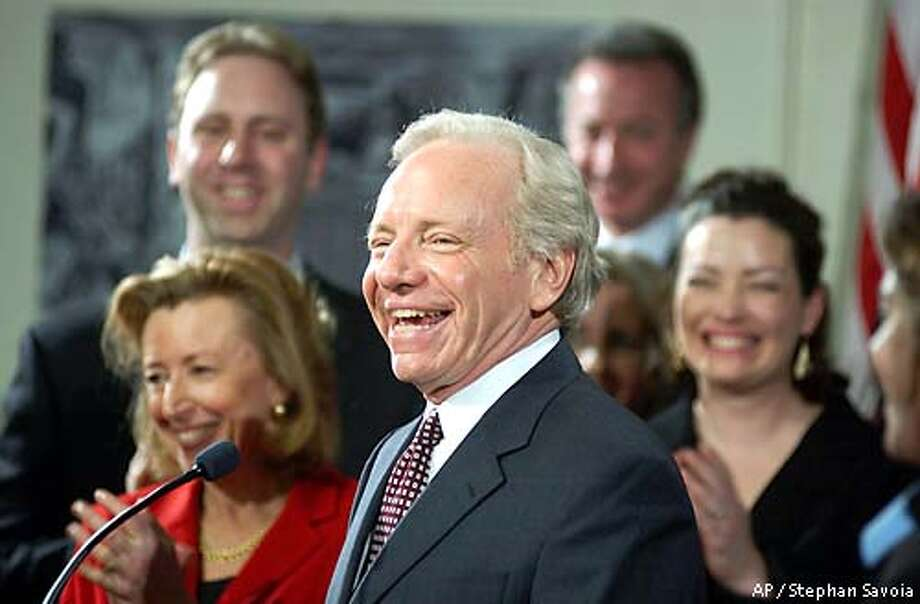**RETRANSMISSION TO FIX NAME OF PHOTOGRAPHER **U. S. Sen. Joseph I. Lieberman, D-Conn., laughs at the podium during an appearance in Stamford, Conn., Monday, Jan. 13, 2003 where he announced he will seek the Democratic presidential nomination in 2004. (AP Photo/Stephan Savoia) Photo: STEPHAN SAVOIA
