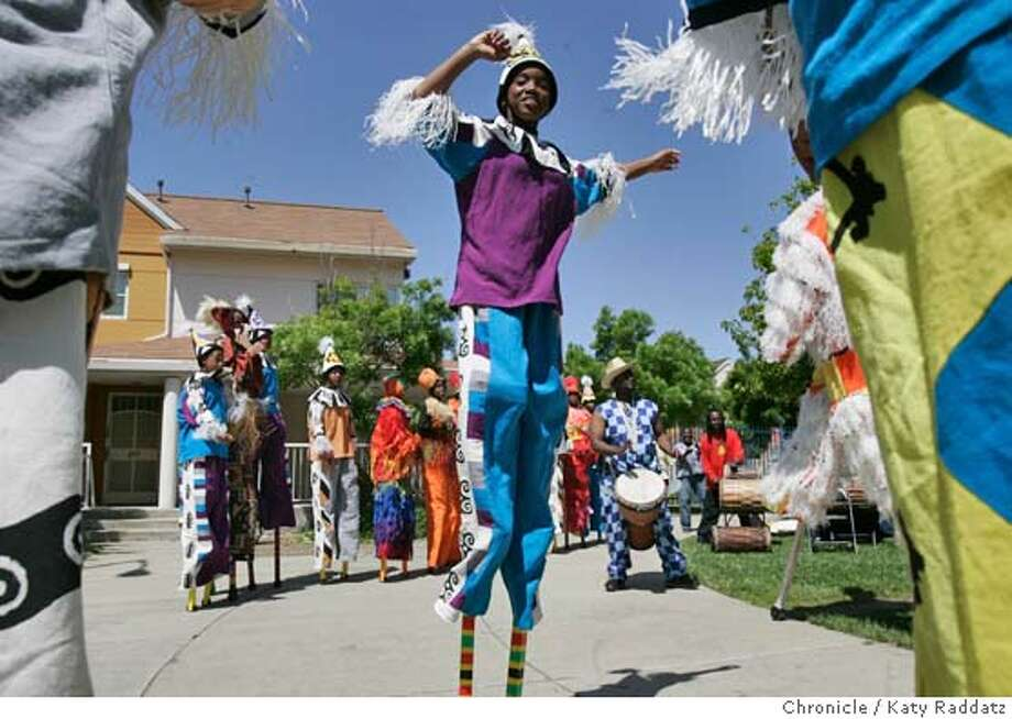 CIRCUS15040_RAD.JPG SHOWN: DeMarcello Funes, age 14, performs with the rest of the stilt dancers. Kids from one of Oakland's poorest neighborhood schools (Prescott Elementary) have learned the art of stilt dancing, and are performing at Campbell Village Courtyard. The performance is called Higher Ground, and the kids study circus arts at the Prescott Circus Theater after school program. Photo taken on 4/14/05, in Oakland, CA.  By Katy Raddatz / The San Francisco Chronicle MANDATORY CREDIT FOR PHOTOG AND SF CHRONICLE/ -MAGS OUT Photo: Katy Raddatz
