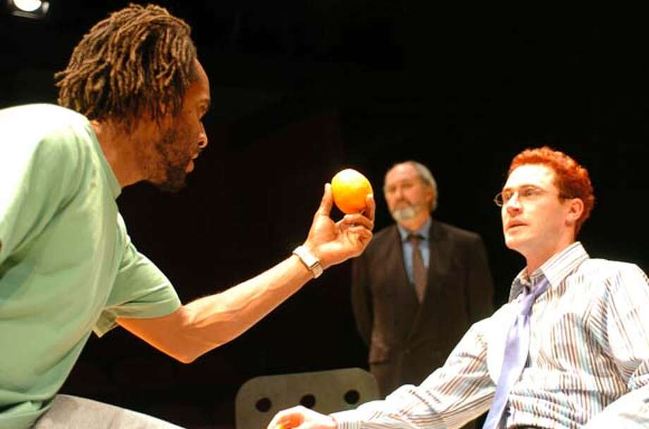 Psychiatric patient Christopher (l. Paul Oliver) talks about the meaning of oranges with Dr. Flaherty (seated, T. Edward Webster), while Dr. Smith (back, Paul Whitworth) looks on