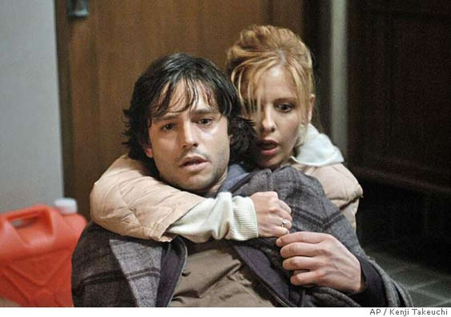 "Jason Behr and Sarah Michelle Gellar star in Columbia Pictures horror thriller, ""The Grudge."" (Columbia Pictures/Kenji Takeuchi) Datebook#Datebook#Chronicle#10/22/2004##Advance##0422419518 Photo: KENJI TAKEUCHI"