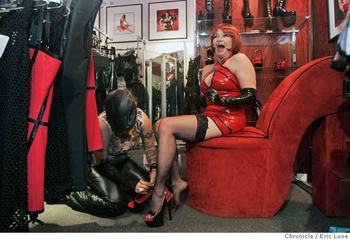 erotic2_033_el.jpg Susan shopping at Madame S in San Francisco for the eroctic ball. Fetish specialist Natasha Red Elk (stage name) helps her with various outfits including her favorite the latex red dress. SUSAN O'NEIL is a veteran of the exotic erotic ball. she's been to about 20 of them. need pictures of her (she'll be in her sausalito apartment) & copy shots of her from photos of past balls she's attended. Event on 10/21/04 in San Francisco. Eric Luse / The Chronicle MANDATORY CREDIT FOR PHOTOG AND SF CHRONICLE/ -MAGS OUT Metro#Metro#Chronicle#10/22/2004#ALL#5star##0422423408