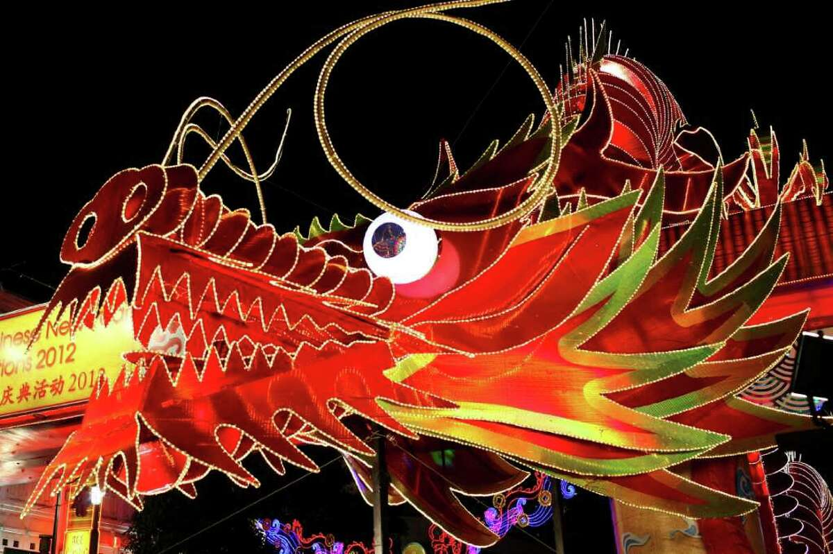 A large illuminated dragon is seen in Chinatown on January 22, 2011 in Singapore. Thousands of people converged on Chinatown to usher in the Year of the Water Dragon. For the Chinese, The Year of the Water Dragon is said to bring abundance, and good fortune.