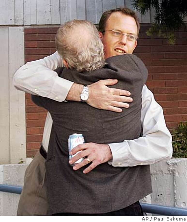Bob Thatcher, facing camera, hugs attorney Jeff Anderson, after a jury awarded nearly $2 million in damages to Thatcher and his brother Tom, in Hayward, Calif., Wednesday, April 13, 2005. Bob and Tom Thatcher, molested by a priest more than two decades ago, were awarded nearly $2 million in damages by a jury Wednesday. The case involving the Thatchers was closely watched because it is the first in a series of sex-abuse lawsuits to seek punitive damages. (AP Photo/Paul Sakuma) Photo: PAUL SAKUMA
