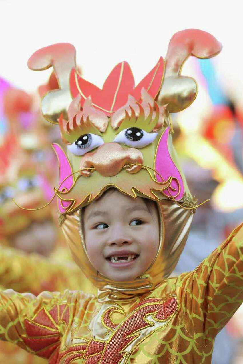 A Chinese young performer dressed in dragon costumes prepares to perform at a temple fair to celebrate the Lunar New Year of Dragon on January 22, 2012 in Beijing, China. Falling on January 23 this year, the Chinese Lunar New Year, also known as the Spring Festival, which is based on the Lunisolar Chinese calendar, is celebrated from the first day of the first month of the lunar year and ends with Lantern Festival on the Fifteenth day.
