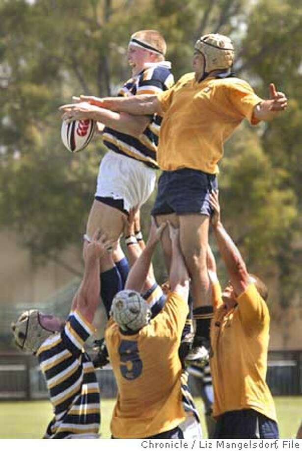 Event on 4/30/04 in San Francisco.  Cal's #5 Louis Stanfill, left, and Navy's #6 Will Cocos (right) are lifted up by teammates as the ball is thrown in to Stanfill.  UC Berkeley men's rugby team plays Navy in the Men's Collegiant semi-finals at stanford. Cal beat Navy 32-15.  Liz Mangelsdorf / The Chronicle Photo: Liz Mangelsdorf