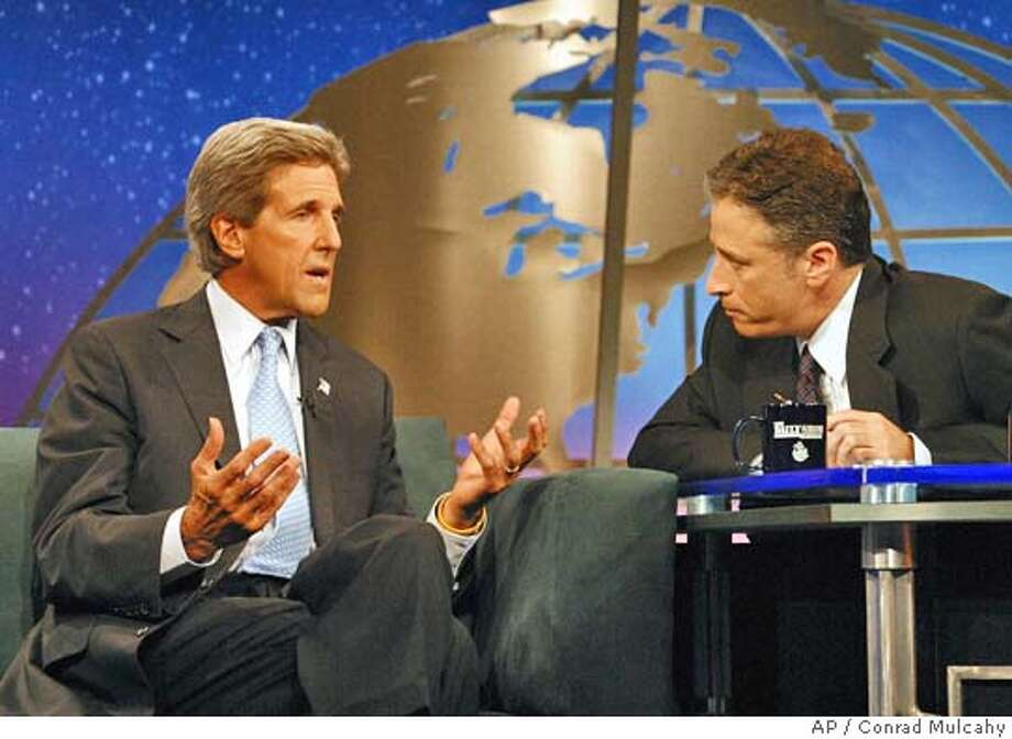 """** FILE **Democratic presidential nominee Sen. John Kerry, D-Mass., left, appears on Comedy Central's """"The Daily Show with Jon Stewart,"""" in this Aug. 24, 2004, file photo in New York. (AP Photo/Conrad Mulcahy/FILE) Nation#MainNews#Chronicle#10/21/2004#ALL#5star##0422410637 Photo: CONRAD MULCAHY"""