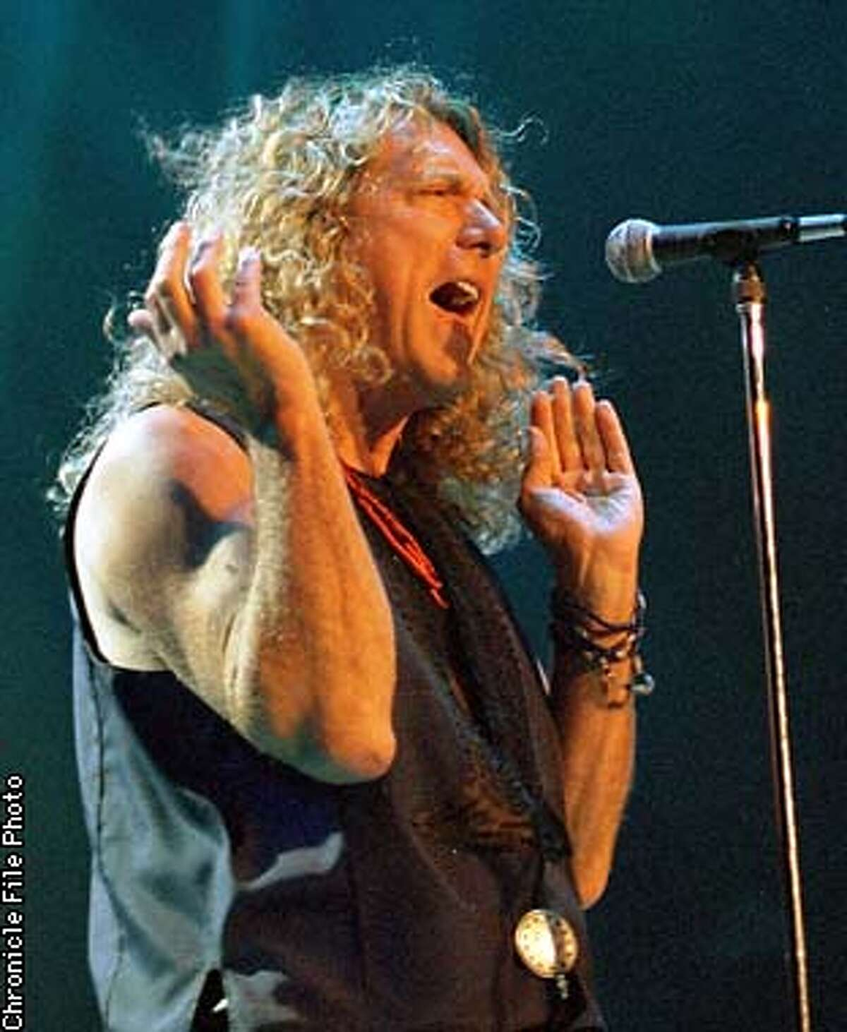 Former vocalist of Led Zeppelin Robert Plant during his concert with guitarist Jimmy Page at the OAkland Coliseum, Friday May19,1995. Chronicle Photo By: Peter DaSilva
