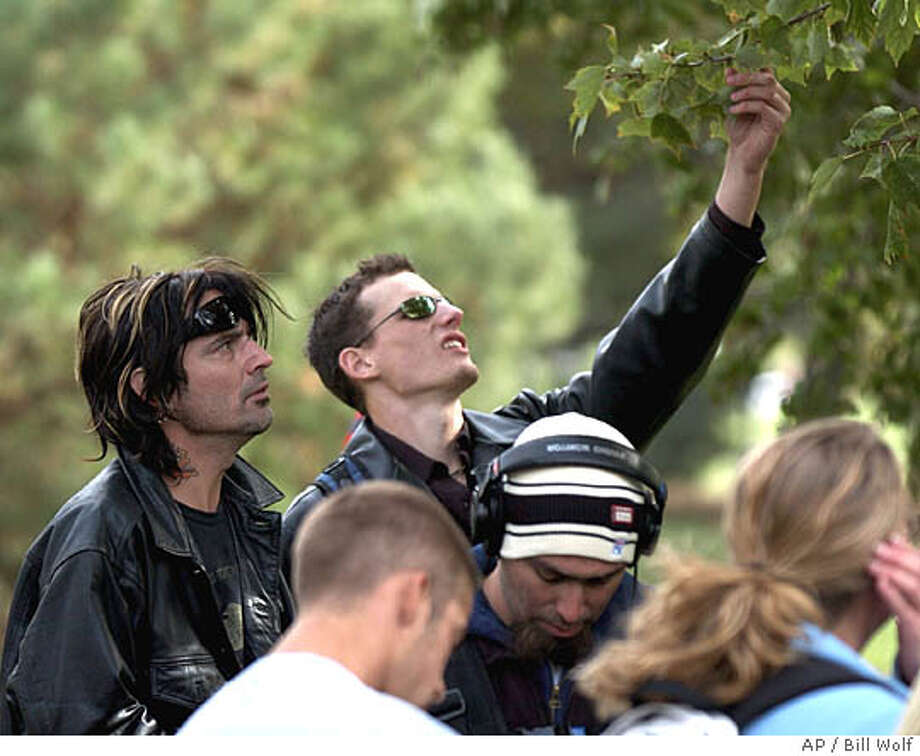 Tommy Lee, left, 42-year-old former drummer of the Motley Crue rock band and ex-husband of Pamela Anderson, participates in a walk-around horticulture exam at the University of Nebraska in Lincoln Friday, Oct. 15, 2004, during filming of a six-part, half-hour reality show to air next summer on NBC. (AP Photo/Bill Wolf) Photo: BILL WOLF