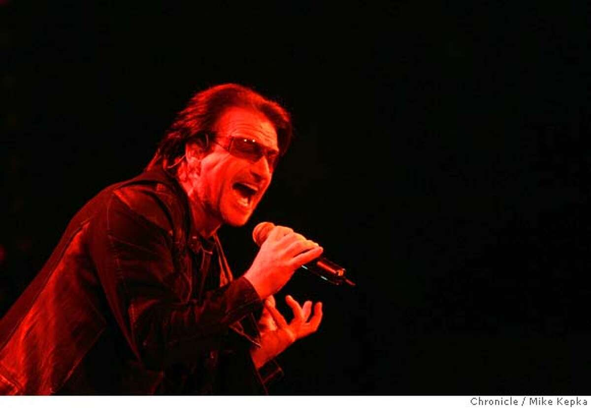 U211193_mk.jpg Lead by singer interantional rocker, Bono, U2 performs at the HP Palvilian Saturday night. 4/9/05 Mike Kepka / The Chronicle MANDATORY CREDIT FOR PHOTOG AND SF CHRONICLE/ -MAGS OUT