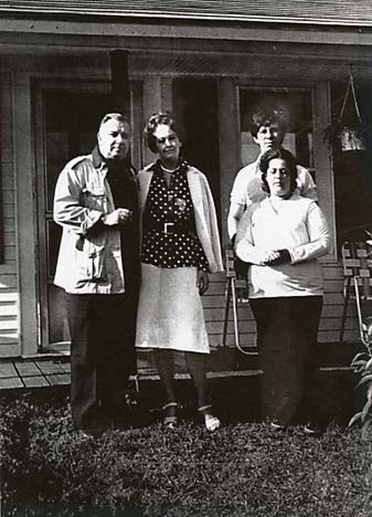 Demonologist Ed and Lorraine Warren (left) with Lui and Dale Passetto, whose home was supposedly inhabited by super natural forces. Credit: UPI 1981.