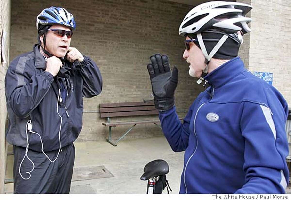 (NYT16) WASHINGTON -- April 10, 2005 -- WHITEHOUSE-LETTER -- President Bush, left, with his iPod at the ready, preparing to continue a ride on his mountain bike in February 2005. Bush is talking with Mike Hammanwright of Aquia Harbour, Va., during a break in Quantico, Va. (Paul Morse/The White House via The New York Times) XNYZ