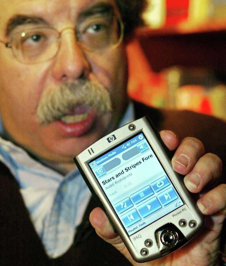 """Microsoft has been beating the speech and text recognition drums for decades, only to see Siri, a quirky, accent-fussy smart agent (there's a term you probably haven't seen in a while) steal any and all thunder that Microsoft had even thought of years before, but not in a mobile context,"" Miller wrote, referring to Siri on the Apple iPhone 4S. Here, then-Microsoft Vice President of Automotive Technology Dick Brass uses Microsoft Voice Command on a Windows Mobile-based Pocket PC on Nov. 3, 2003. Photo: Getty Images / Microsoft"