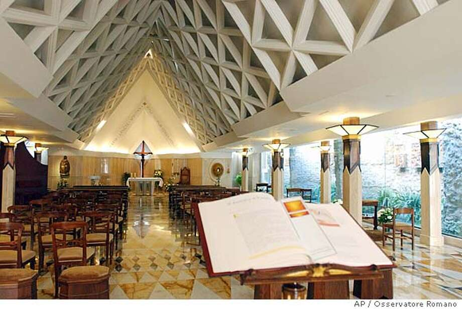 A photo made available by the Vatican newspaper L'Osservatore Romano showing the church inside the Domus Sanctae Marthae at the Vatican, Monday, April 11, 2005. The Domus Sanctae Marthae is the hotel-residence that will house all 115 Cardinals during next week's conclave to elect the future Roman Catholic pontiff. (AP Photo/Osservatore Romano, ho)