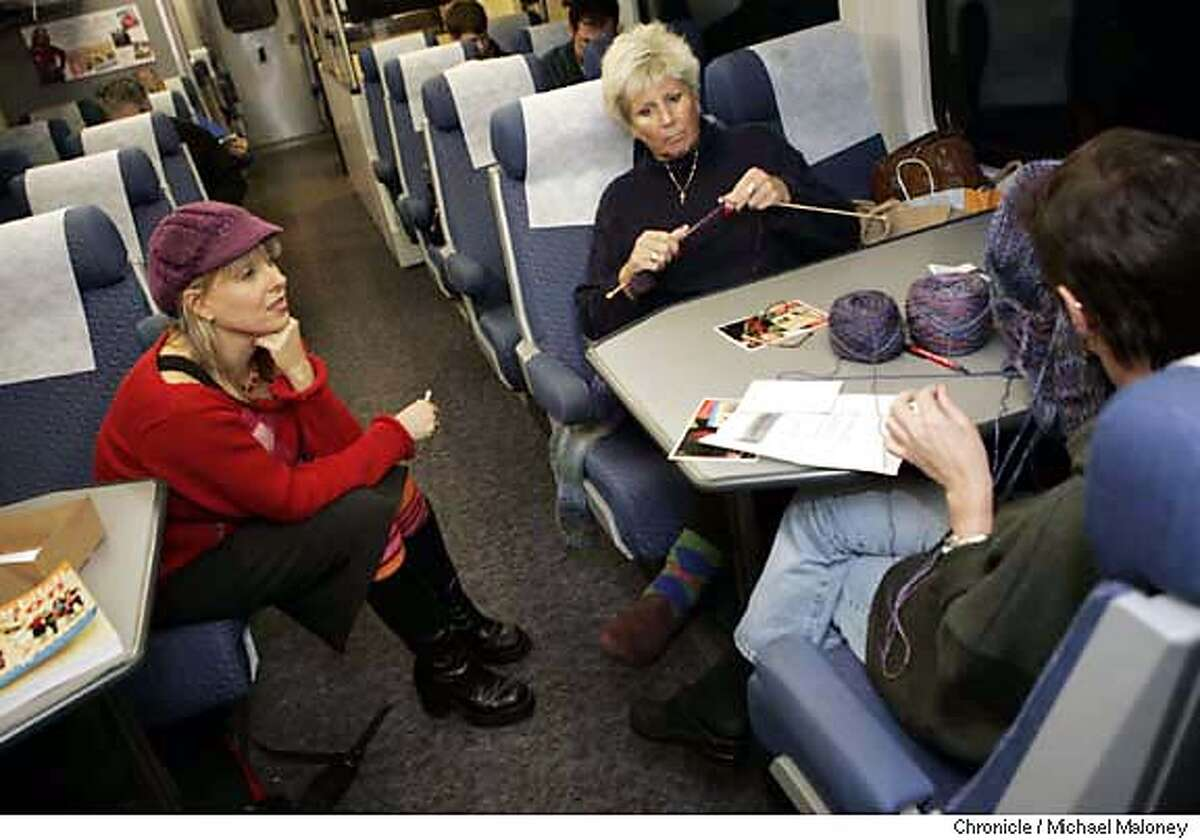"""KNITTER03_109_MJM.jpg Debbie Stoller (left) chats with knitters Gayle King of Walnut Creek (center) and far right, Paulette Pardi of Concord. Debbie Stoller is the author of a bestselling book called """"Stitch & Bitch"""" - a book all about knitting. In cooperation with Amtrack, she leads a group of knitters on weekly trips to and from Oakland and Sacramento where they """"knit and bitch"""". This trip headed east to Sacramento with about a dozen knitters on board. Photo by Michael Maloney / San Francisco Chronicle MANDATORY CREDIT FOR PHOTOG AND SF CHRONICLE/ -MAGS OUT"""