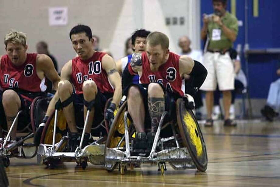 "U.S. Paralympic Rugby Team Captain Mark Zupan and teammates in THINKFilm�s ""Murderball."" Photo by Jack Rowand."