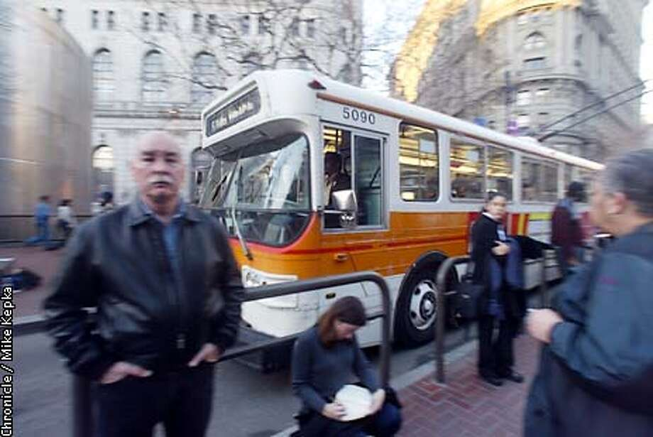 Evening MUNI riders wait for their bus on Market and Powell. MUNI rates will be going up to $1.25. BY MIKE KEPKA/THE CHRONICLE Photo: MIKE KEPKA